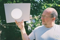 Tony with a projection of the transit of Venus on a white card.